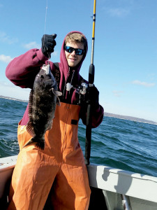 Sean Cody of Middletown, with a fat Long Shot black- fish. Photo: Chris Bauer