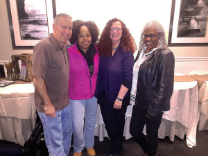 Jim Mizell of Keyport, Tarika Jean-Pierre of Neptune, Amy Broza of Neptune and Hollis Cooper of Long Branch before prepping their voices for the recent Holiday Express rehearsal.