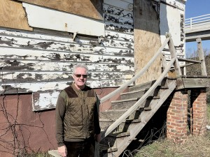 "Rumson's Hank Sandlass outside his childhood home in Sea Bright last week. His sister Susan Sandlass Gardiner heads the ""Save Sandlass"" coalition whose goal is to save and move the house for repurposing while preserving the history of the iconic Highland Beach resort. Photo: Rick Geffken"