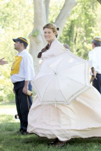 Abigail Murphy cheers on the MFBBC from the stands in a hoop skirt dress she sewed herself.