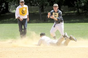 A close play at second base as the MFBBC steal a base
