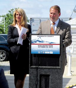 Monmouth County Freeholder Serena DiMaso and Sheriff Shaun Golden introduce the new Super Storm Sandy high- water mark signs.