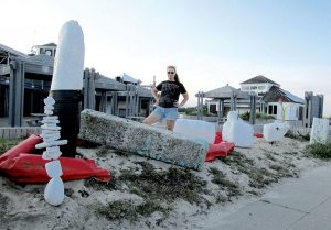 Laura Petrovich-Cheney stands amid her sculptures of plastic foam debris at Sandy Hook's Area D.
