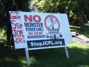 A residential sign advertises opposition to the JCP&L power line project.