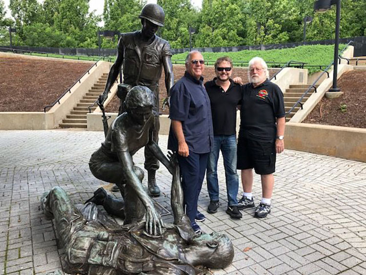 Standing next to the statue of a fallen American soldier at the New Jersey Vietnam Veterans Memorial in Holmdel are, from left, Ernie Diorio, filmmaker Tom Phillips and Rich Gough. Diorio and Gough are members of the New Jersey Shore Area Chapter 12 of the Vietnam Veterans of America.